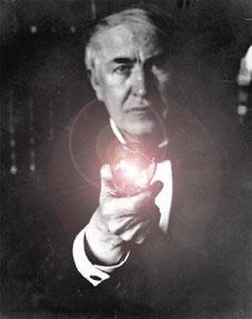 Thomas Edison holding light bulb