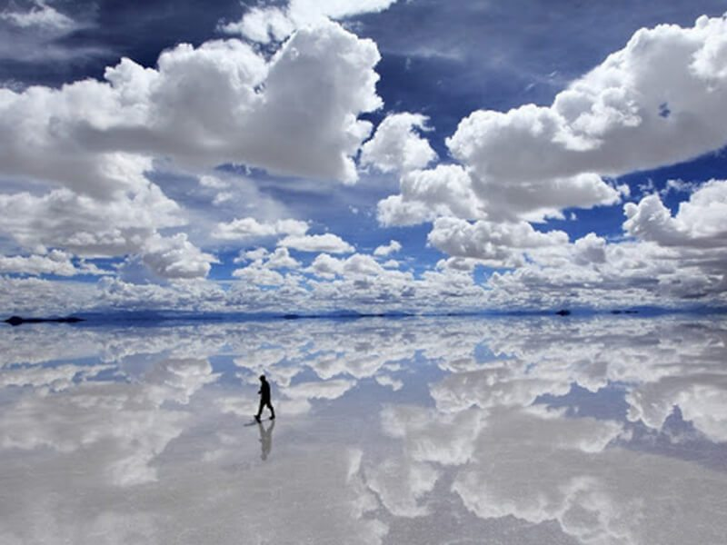 man appears to walk in clouds (reflection)