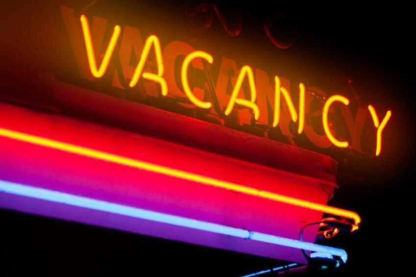 neon sign says vacancy