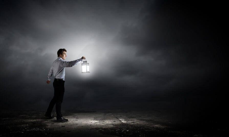 Man with lantern in the dark