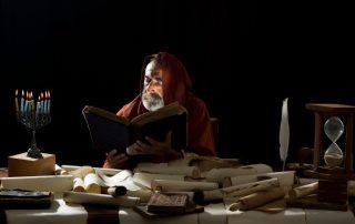 Prophet examining the scriptures