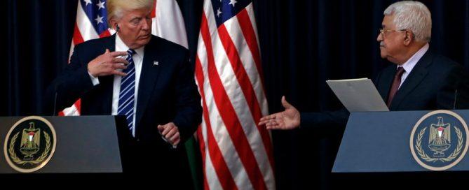 Trump and Abbas shake hands