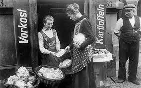 Woman with baskets of money in Weimar Germany 1926